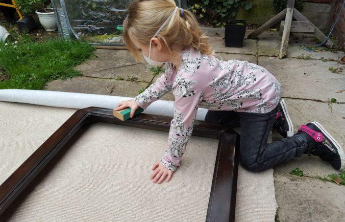 Girl sanding wood